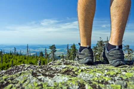 Legs of hiker on summit in mountains Stock Photo - 11017362