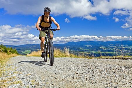 Mountain biking in summer mountains photo