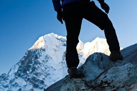 Silhouette of man hiking in Himalaya Mountains in Nepal photo