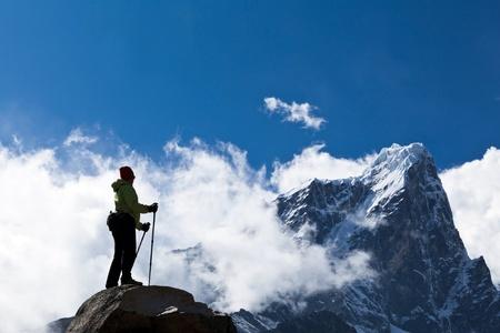 himalayas: Young woman hiker hiking in Himalaya Mountains in Nepal Stock Photo