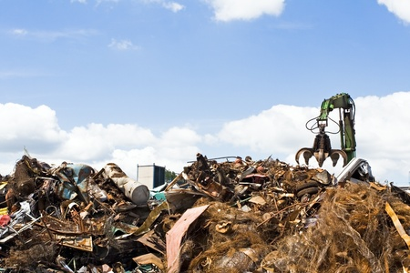 landfill site: Metal recycling site over blue sky Stock Photo