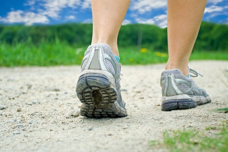 Woman walking on trail in summer photo