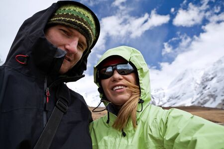 Couple hiking in Himalaya Mountains in Nepal photo