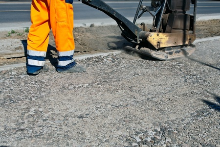machine man: Worker on a road construction