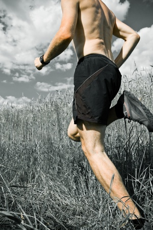 trail running: Man running cross country on trail, sport and fitness outdoors