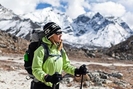 Young woman hiker hiking in Himalaya Mountains in Nepal Stock Photo
