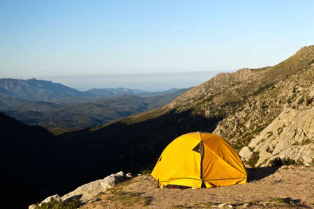 Camping and tent in mountains photo