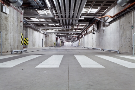 Parking garage, underground interior with zebra crossing