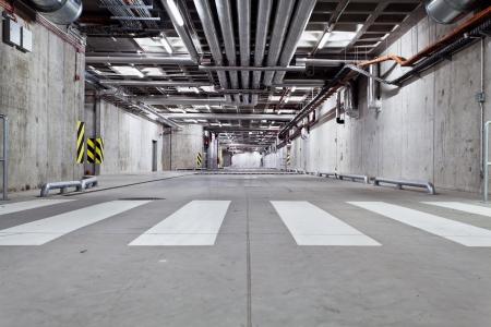 parking lot interior: Parking garage, underground interior with zebra crossing Editorial