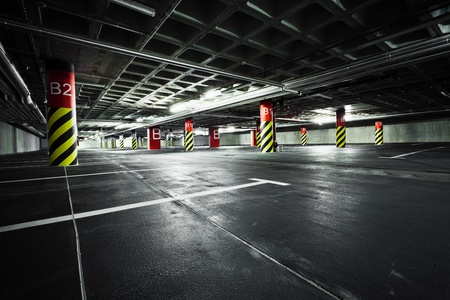cars parking: Parking garage underground interior Editorial