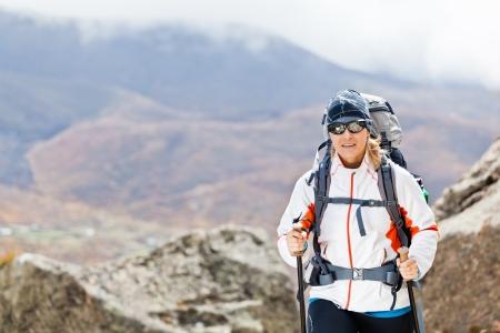 Young woman trekking in Himalaya Mountains in Nepal photo