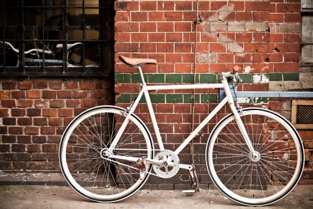 City bicycle fixed gear and red brick wall