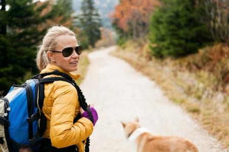 Woman hiking in mountains with akita dog, Karkonosze Mountain Range