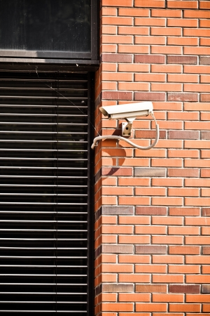 building safety: White security camera on office building, safety system
