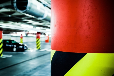 Parking garage underground interior  Bright neon light in industrial building basement, steel and concrete  Stock Photo - 24036376