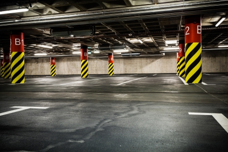 Parking garage underground interior. Bright neon light in industrial building basement, steel and concrete. Stock Photo - 16221143