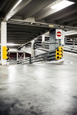 Parking garage in basement, underground interior photo