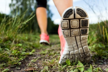 power walking: Walking or running legs in forest, adventure and exercising in summer nature