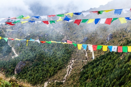 Nepal and and tibetan colorful prayer flags in mountains. Namche Bazaar valley in Himalayas. Stock Photo - 16724450