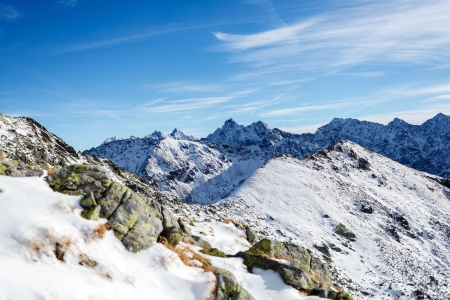 Mountains landscape in winter in Tatras. Mountain ridge over blue sunny sky, Poland photo