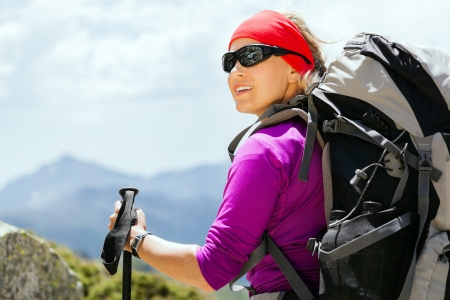 Woman hiking with backpack in mountains, Corsica France. Success and achievement, sport, exercising outdoors in summer nature photo