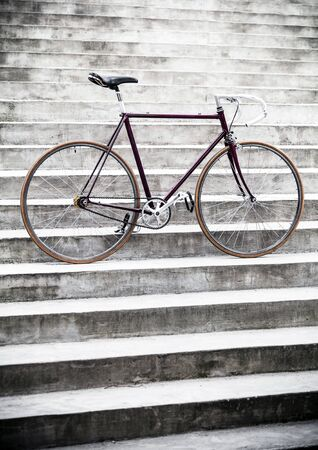 City bicycle fixed gear and concrete wall. Classic style road bike on stairs. photo