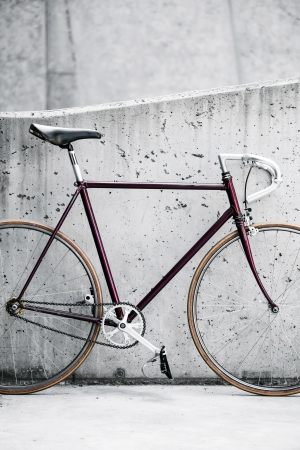 City bicycle fixed gear and concrete wall photo