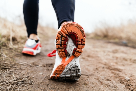 running shoes: Walking or running legs sport shoes, fitness and exercising in autumn or winter nature.