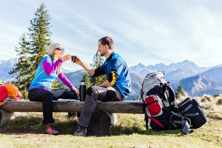 Man and woman, hikers camping in mountains photo