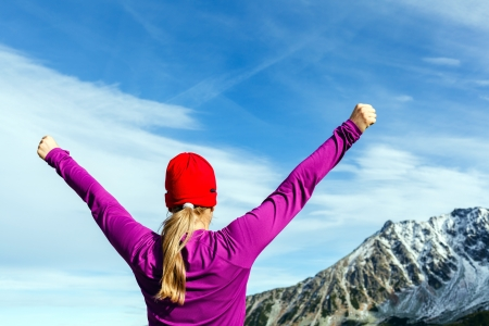 Hiking woman and success in mountains Stock Photo - 19838655