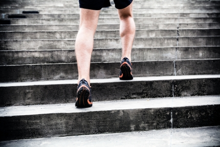 interval: Man runner running on stairs in city Stock Photo