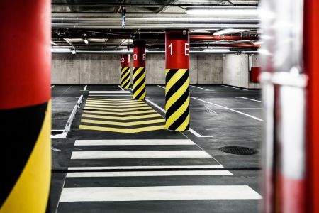 Parking garage underground interior, pedestrian crossing, neon lights in dark industrial building, modern public construction photo