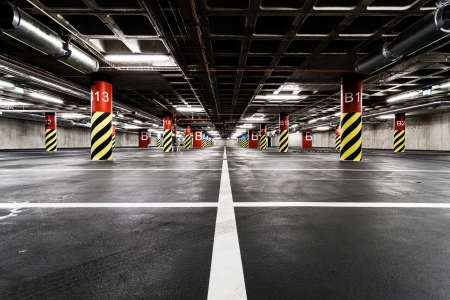 Parking garage underground interior, neon lights in dark industrial building, modern public construction photo
