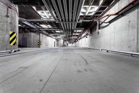 parking lot interior: Parking garage underground interior, neon lights in dark industrial building, modern public construction