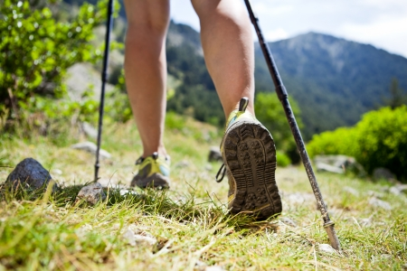 trekking pole: Woman hiking in mountains, adventure and exercising