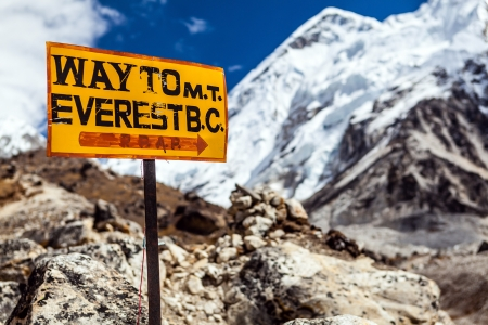 icefall: Footpath to Mount Everest Base Camp signpost in Himalayas, Nepal. Khumbu glacier and valley snow on mountain peaks, beautiful view landscape
