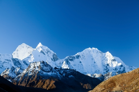 Mount Ama Dablam in Himalaya Mountains, Nepal. Beautiful Himalayan landscape on sunny autumn day. photo