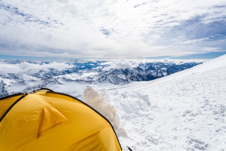 tent on Mount Elbrus trail to the top, Mountain landscape in autumn or winter in Caucasus Mountains in Russia and Georgia photo