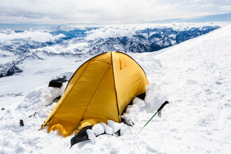 elbrus: tent on Mount Elbrus trail to the top, Mountain landscape in autumn or winter in Caucasus Mountains in Russia and Georgia