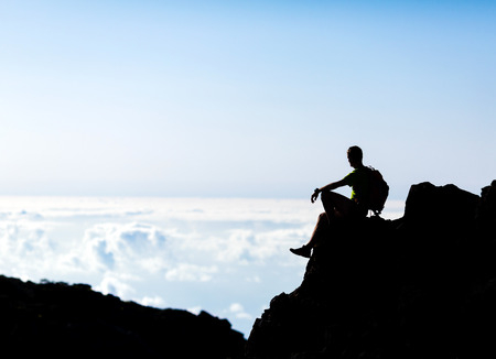 Hiking or running silhouette backpacker, man and success in mountains on mountain peak  Fitness and healthy lifestyle outdoors in summer nature on La Palma, Canary Islands