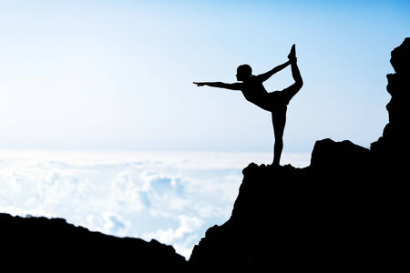 yoga silhouette: Young woman doing beautiful yoga pose king of the dancer, sunset silhouette in mountains over blue sky and clouds with sun sunlight background  Healthy lifestyle successful fitness exercise concept