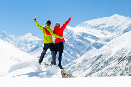 achievement: Hiking woman and success in mountains. Fitness and healthy lifestyle outdoors in winter nature Stock Photo
