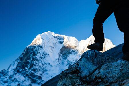 Silhouette of man hiking in Himalaya Mountains in Nepal