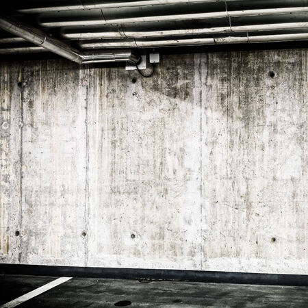 parking garage: Concrete Wall Construction in Parking Garage Underground Interior background or texture. Concrete grunge wall, industrial retro vintage interior.