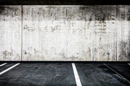 Parking garage underground interior background or texture. Concrete grunge wall and asphalt road, industrial retro vintage interior. photo