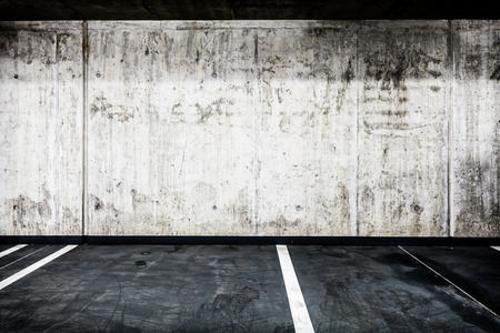 parking garage: Parking garage underground interior background or texture. Concrete grunge wall and asphalt road, industrial retro vintage interior.