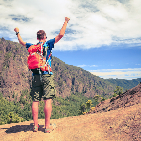 human arms: Hiking or trail running man in mountains. Happy adventure backpacker hiker success. Motivation inspiration concept fitness and healthy lifestyle outdoors in summer nature La Palma on Canary Islands.