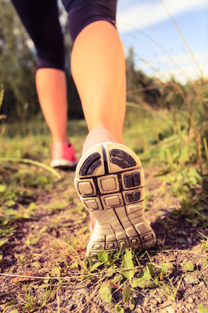 fitness motivation: Walking or running exercise legs on a footpath in forest inspiration motivation achievement Fitness concept outdoors adventure and exercising in spring or summer nature