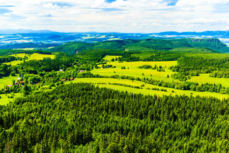 blue green landscape: Summer landscape with green forest and beautiful inspirational mountains. Blue sky and white clouds, Poland Europe.