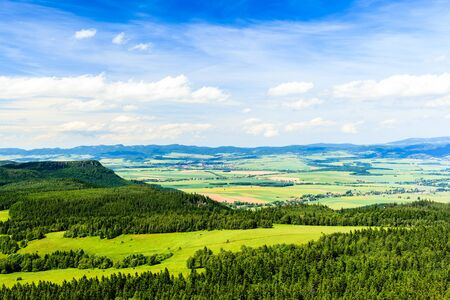 blue green landscape: Summer landscape with green forest and beautiful inspirational landscape and mountains. Blue sky and white clouds Poland Europe. Stock Photo